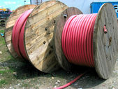 HV cable on wooden spool — Stock Photo