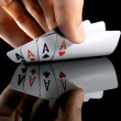 Four aces in the hands - Stock Photo