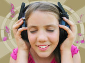 Girl listening music — Stockfoto