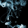 Blue colored smoke - Stock Photo