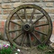 Old coach wheel - Stock Photo