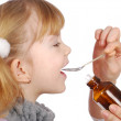 Little girl take medicine — Stock Photo