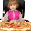 Little girl with pizza — Stock Photo