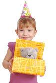 Little girl with birthday gift — Stock Photo