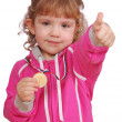 Little girl with golden medal and thumb - Stock Photo