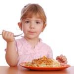 Little girl eating spaghetti — Stock Photo