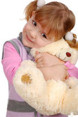 Beauty little girl with teddy-bear — Stock Photo