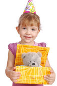 Little girl with birthday gift — Stockfoto