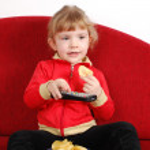 Little girl watching tv — Stock Photo #2539945