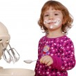 Little girl made cream for cake — Stock Photo