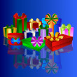 Colorful presents on blue background — Stock Photo