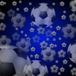 Blue background with flying soccer balls — Stock Photo #1764100