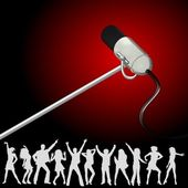 Huge microphone with dancers — Stock Photo