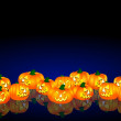 Halloween pumpkins background blue — Stock Photo #1779310