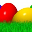 Colored easter eggs in grass — Stock Photo #1784592