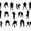 Silhouettes of football players - Stock Photo