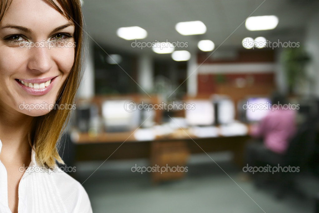 Portrait of pretty businesswoman and colleague on background at office  Stock Photo #1657381