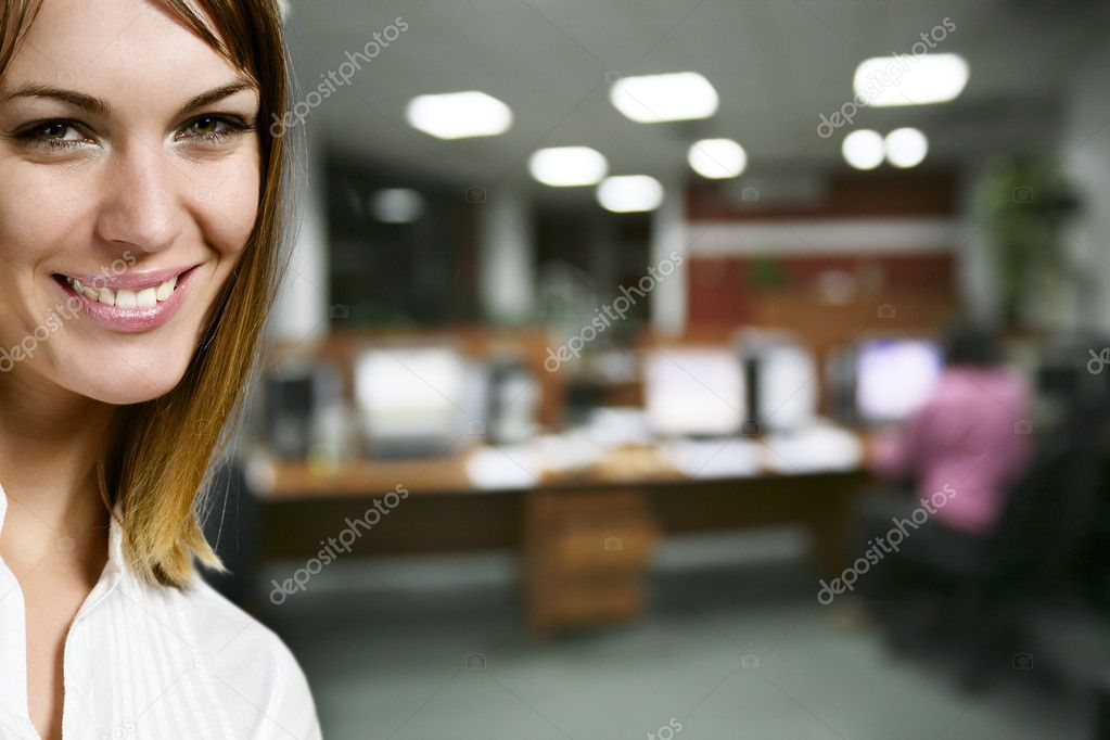 Portrait of pretty businesswoman and colleague on background at office — Foto de Stock   #1657381