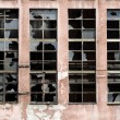 Broken windows on old warehouse — Stock fotografie