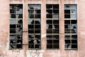 Broken windows on old warehouse — Stock Photo