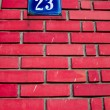 Number on brick wall — Stock Photo