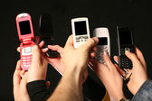 Cell phones in hands — Stock Photo