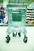 Shopping cart in store — Stock Photo