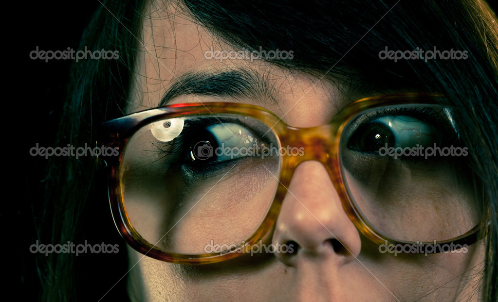 Funny girl wearing geek glasses closeup — Stock Photo #1684119