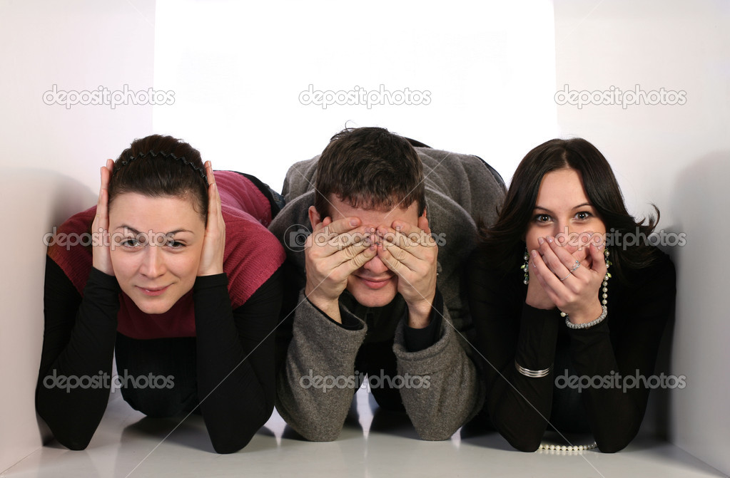 Three young in small space covering ears, mouth and eyes. communication concept — Stock Photo #1689346