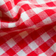 Red picnic cloth closeup - Stock Photo