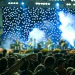 Concert stage lights and crowd - Stock Photo