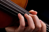 Violin background and fingers — Stock Photo