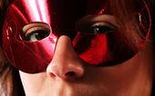 Eyes behind mask — Stock Photo