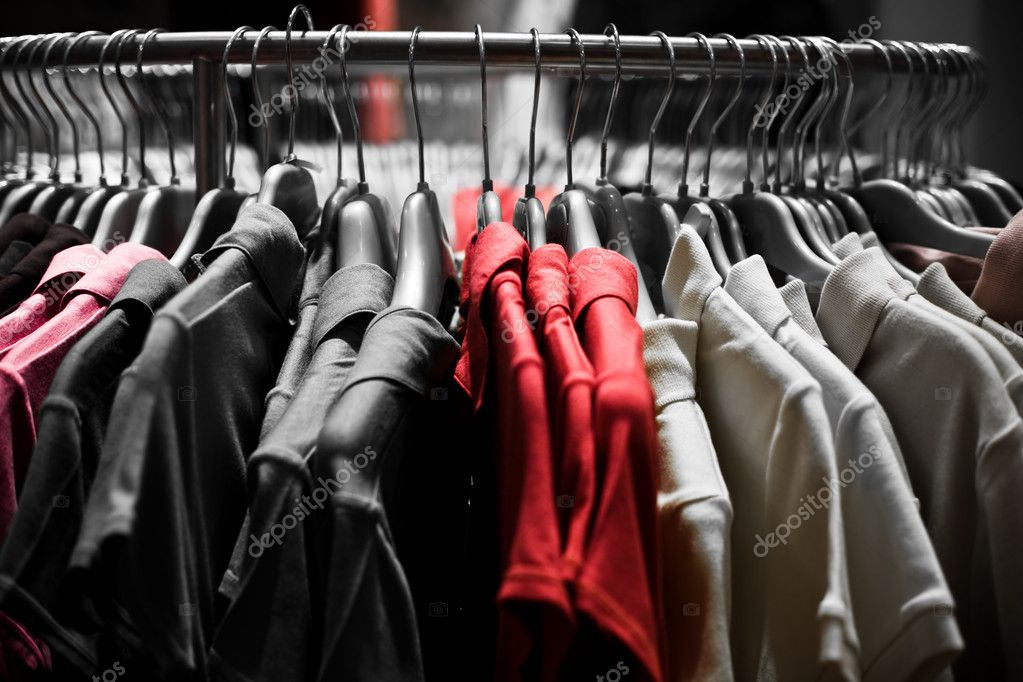 Clothes hangers with red t-shirts in store ready to choose to buy. Fashion shopping concept — Stock Photo #1704397
