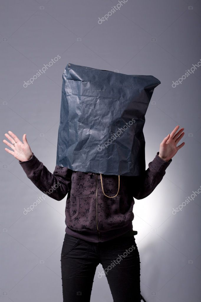 Shopping concept, woman with shopping bag over her head — Stock Photo #1704894