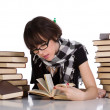 Studying between two pile of books — Stock Photo