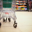 Shopping cart in supermarket — Stock fotografie