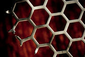 Metal Background hex pattern on red — Stock Photo