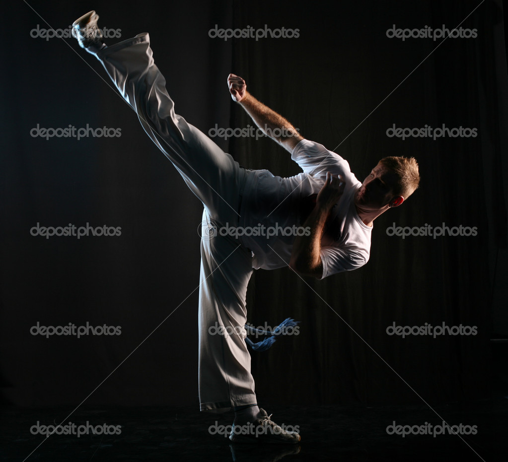 Man in dark practice martial art - high kick — Stock Photo #1755994