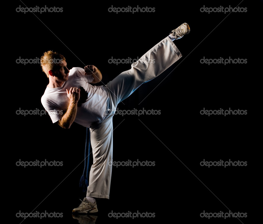 Man in dark practice martial art - high kick — Stock Photo #1756325