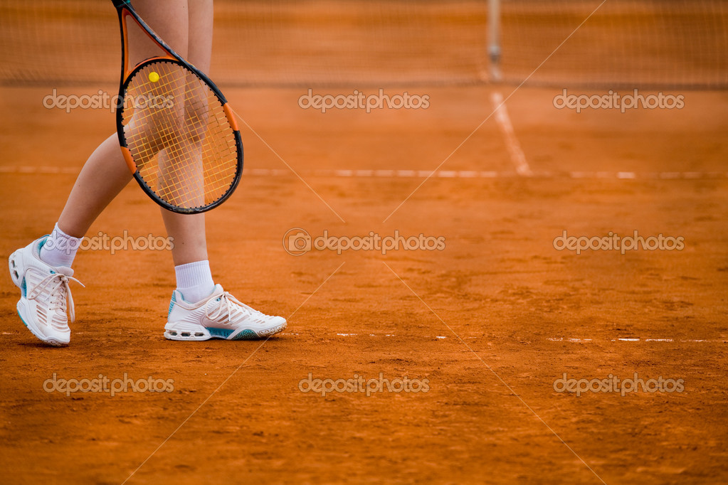 Clay tennis court with Tennis player legs — Stock Photo #1757903
