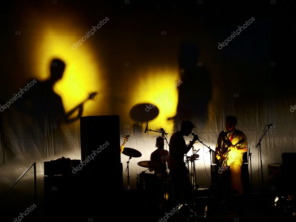 Music band on stage playing — Stock Photo #1758548