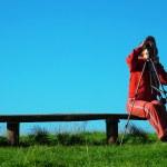 Girl exploring the mountain landskape with spyglass — Stock Photo #1824206