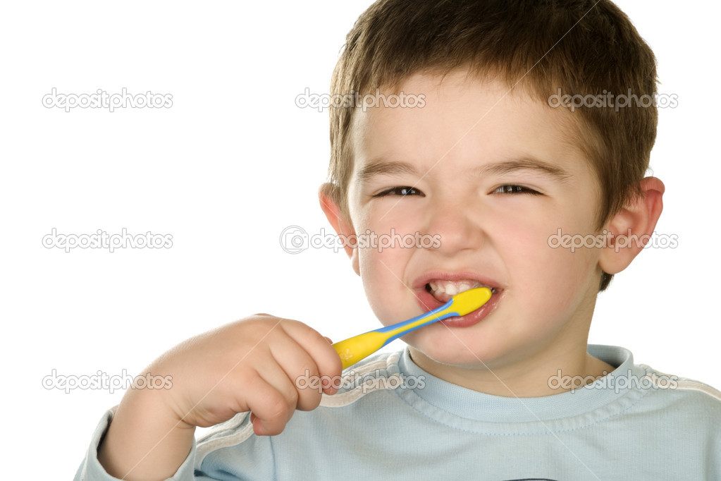Young boy cleans a teeth isolated.  Stock Photo #1644566