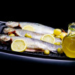 Stock Photo: Trouts, olive, olive oil and lemon
