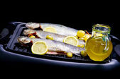 Trouts, olive, olive oil and lemon — Stock Photo