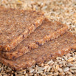 Stock Photo: Wholegrain Bread and Rye Grains