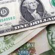 Stock Photo: One dollar and one yuan