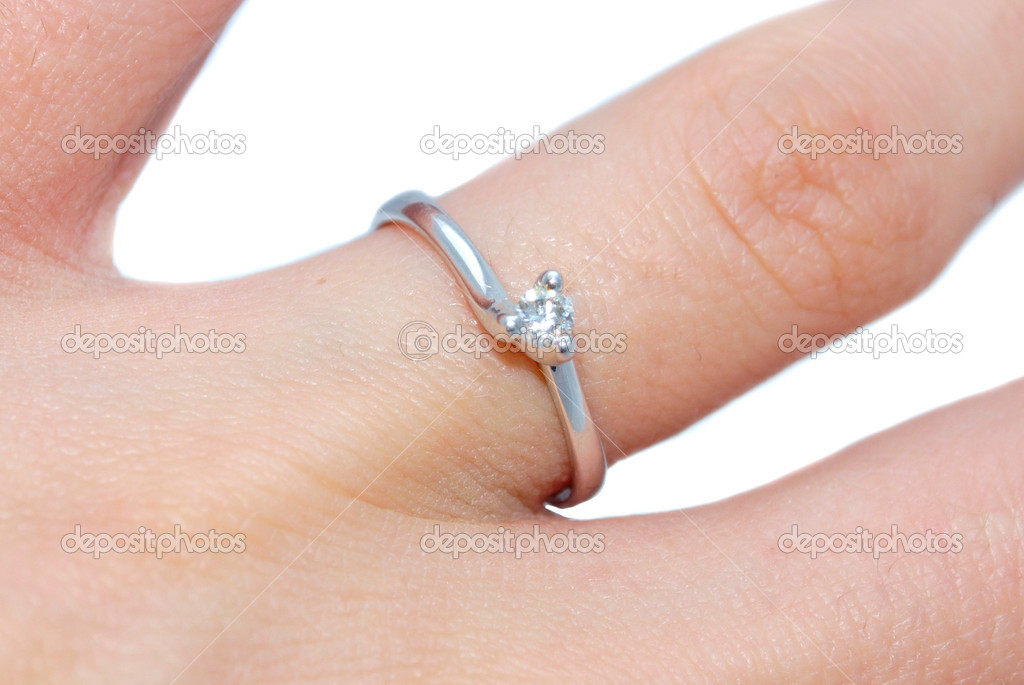 Engagement ring on finger — Stock fotografie #1645055