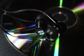 Inear headphones on compact disc — Stock Photo